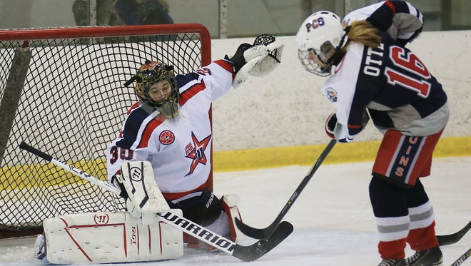 Livonia United goalie Maddie Marciw makes a stop against PCS Penguins player Anna Otte (16) during Wednesday's game at Eddie Edgar Arena.