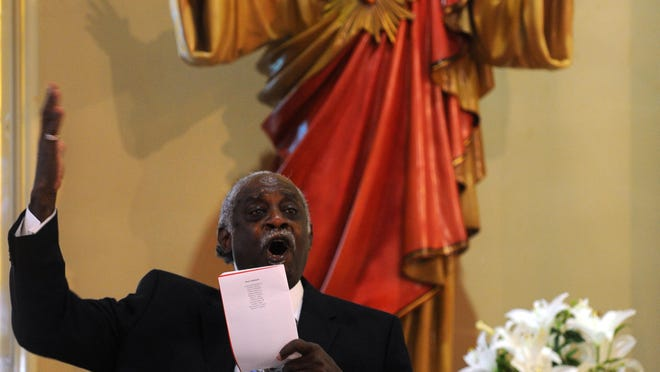 Brady L. Blade, pastor of Zion Baptist Church sings during the 22nd annual Red Mass at Holy Trinity Catholic Church in downtown Shreveport.