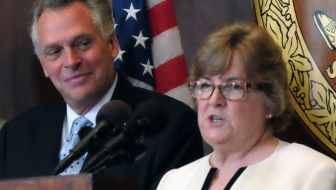Virginia Supreme Court nominee Jane Marum Roush, right, answers a question during a press conference at the Patrick Henry Building in Richmond, Va., Monday, July 27, 2015, as Del. David B. Albo, R-Fairfax, left, and Virginia Gov.Terry McAuliffe, center, look on. Roush, a veteran Fairfax County circuit judge, has presided over high-profile cases such as the Beltway sniper trial.  (Bob Brown/Richmond Times-Dispatch via AP).