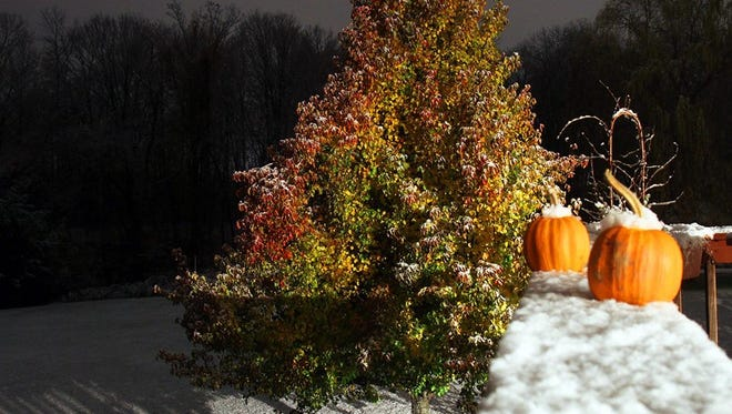 The season's first snow tops pumpkins in Brewster.