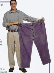 Former Subway pitchman Jared Fogle, in a photo from 2002, displays the jeans he wore when he weighed 425 pounds.