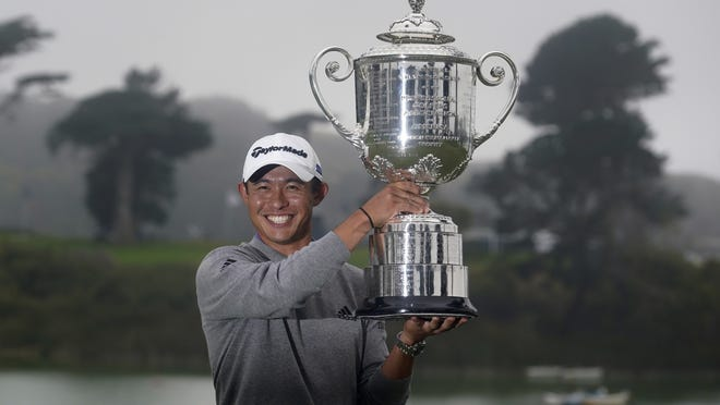 Collin Morikawa holds the Wanamaker Trophy after winning the PGA Championship golf tournament at TPC Harding Park Sunday in San Francisco.