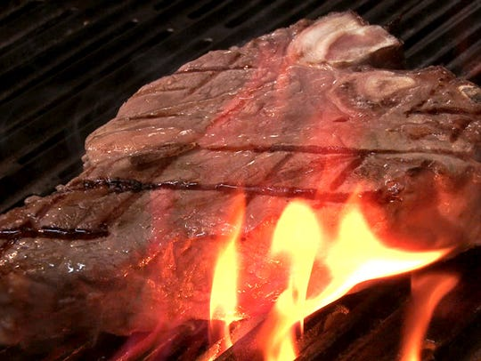 Danny Murphy prepares a Porterhouse steak at Danny's