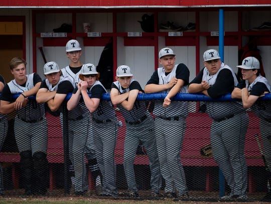 The Trigg County dugout watches as Union County scores