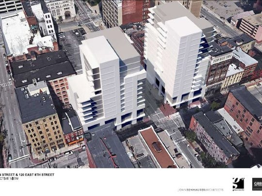The illustration is a concept showing the potential size and scale of a condominium development Greiwe Development Group is contemplating near Main and Eighth Streets. The illustration does not reflect the final look or design of the structure.