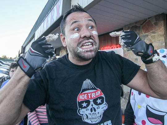 "Contestant Monty ""Moe train"" Wiradilag celebrates after winning Cannon's Bakery inaugural eclair eating contest in September 2017. He placed fifth this year at the Wing Bowl in Philadelphia after eating 250 wings."
