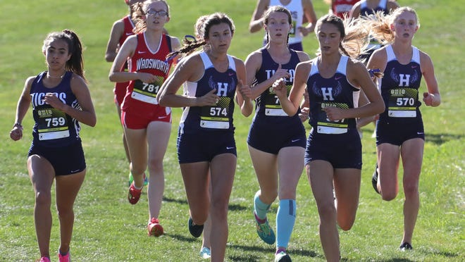 Hudson's Emmaline Hannan (574), Brenna Beucler and Sydney Gallagher (570) run the National Confernece race at the 2019 Suburban League Meet. Hudson returns nearly its entire state qualifying squad from last season.