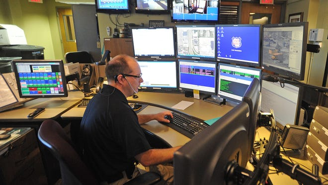 State Patrol District 3 dispatcher Lance Thomas keeps an eye on eight different monitors during his shift at State Patrol headquarters in Fond du Lac.