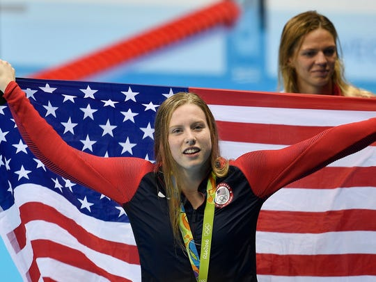 United States' gold medal winner Lilly King celebrates