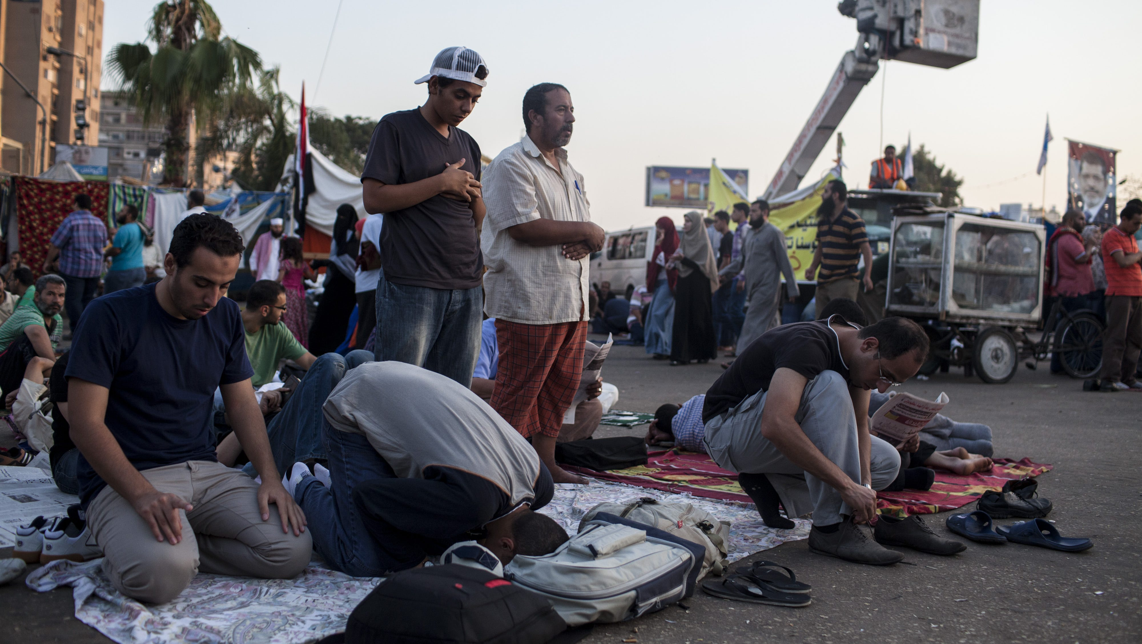 Morsi supporters perform sunrise prayers during a sit-in Aug. 12.