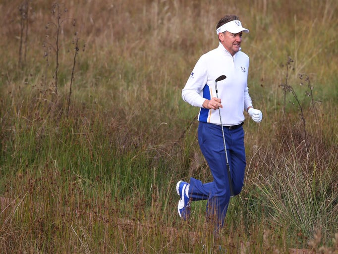 Europe's Ian Poulter runs to the fourth tee.