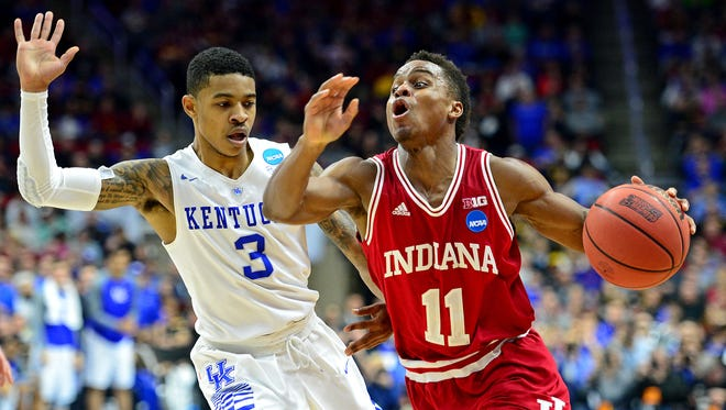 Indiana Hoosiers guard Yogi Ferrell (11) drives to the basket against Kentucky Wildcats guard Tyler Ulis (3) in the second half during the second round of the 2016 NCAA Tournament at Wells Fargo Arena.