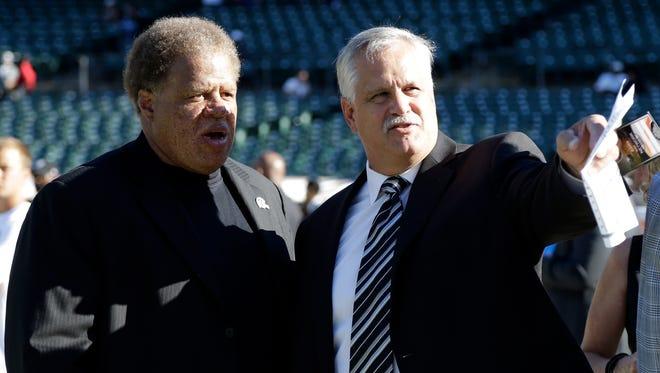 Former NFL player Matt Millen, right, talks with Oakland Raiders general manager Reggie McKenzie before a game Aug. 14, 2015.