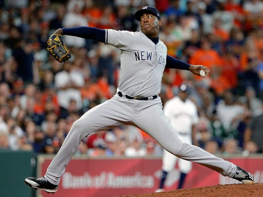 New York Yankees' relief pitcher Aroldis Chapman strikes out Houston Astros' Jose Altuve during the ninth inning of a baseball game Thursday, May 3, 2018, in Houston.