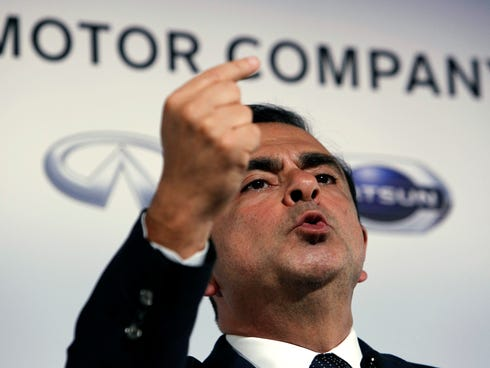 Nissan CEO Carlos Ghosn answers a question today at a press conference at global headquarters in Yokohama, Japan, Nissan  cut its earnings forecast to reflect tougher than expected conditions in many markets and expensive recalls.