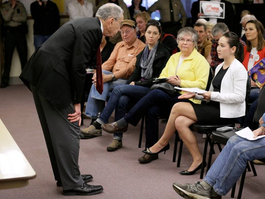 Senate Judiciary Committee Chairman Chuck Grassley, R-Iowa, talks with Sidney Chun of Seattle, Wash., right, during a town hall meeting at the Ocheyedan Senior Center, Monday, March 28, 2016, in Ocheyedan.
