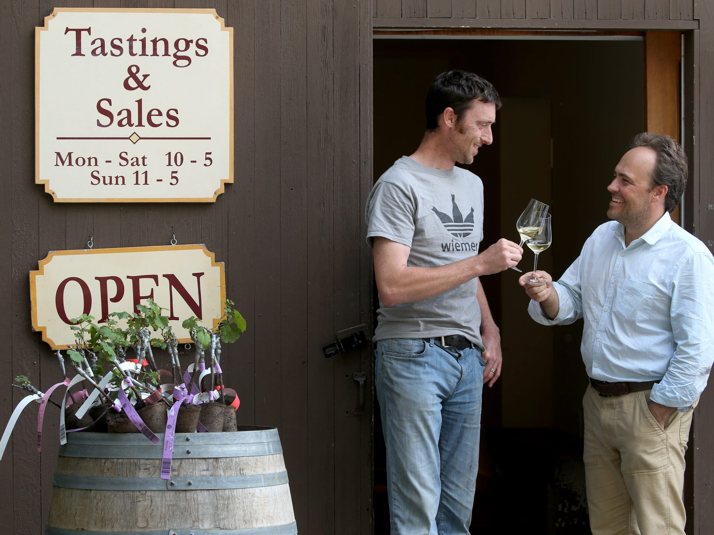 Fred Merwarth and Oskar Bynke outside their tasting and sales barn at Hermann J. Wiemer Winery.
