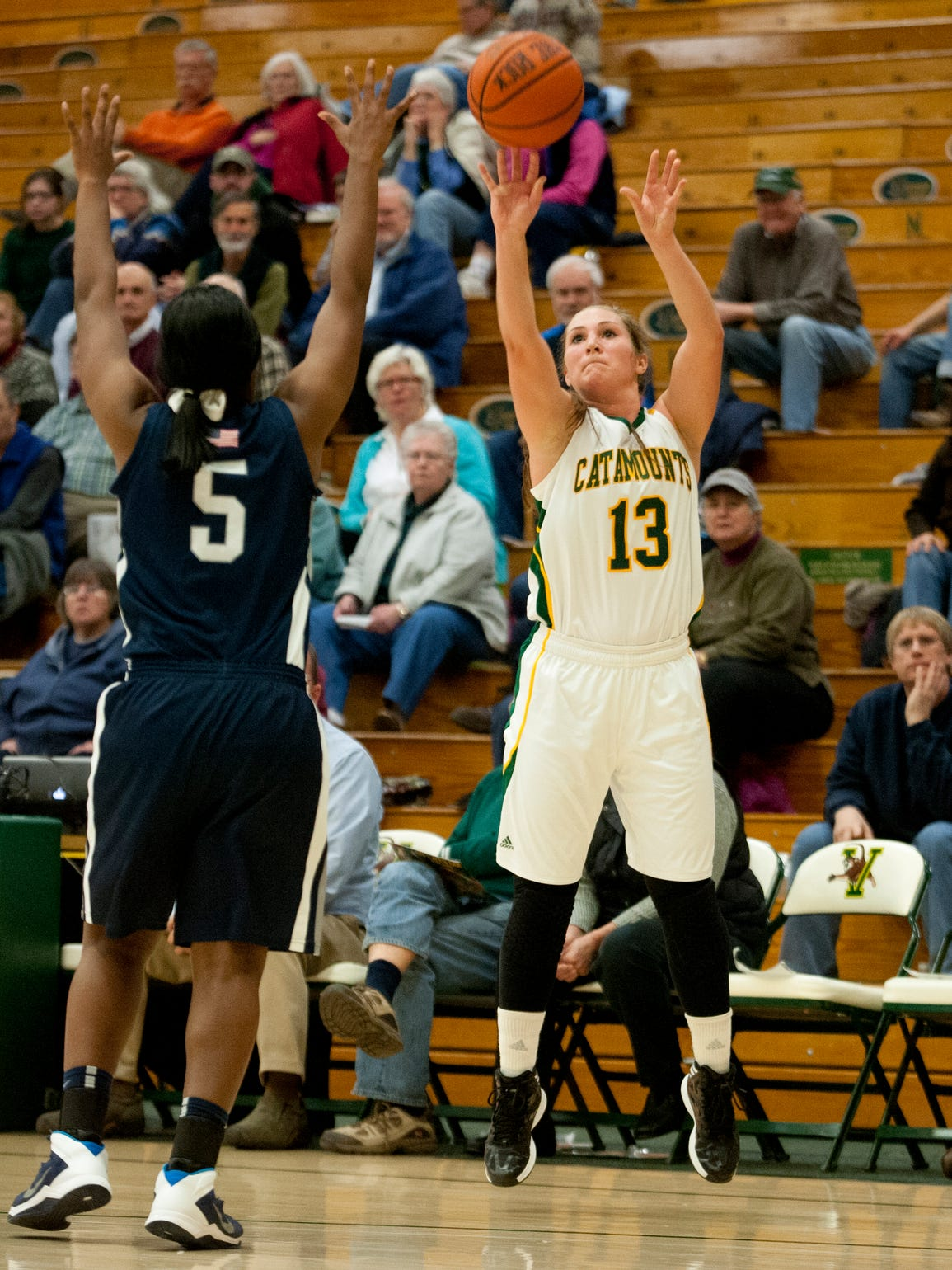 Vermont guard Kristina White, right, lets fly with