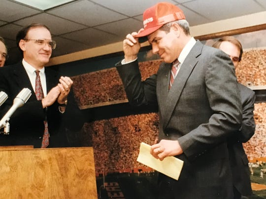 Max Lennon, left, President of Clemson University from 1986 to 1994, claps as Ken Hatfield is named the school's new football coach in January 1990. Hatfield replaced Danny Ford.