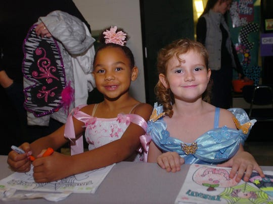 Murphi Gibson (left) dresses as a princess and her friend, Katie Robinson, came as Cinderella to the annual Bingham Boo.