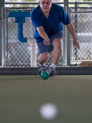 Dave Kotoske  takes aim and lets it roll during a game