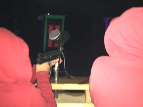Kids took down zombies with paintballs Friday at opening
