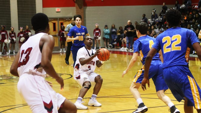 Ouachita hosts Live Oak for the first round of Class 5A boys' basketball playoffs on Friday, February 24, 2017.