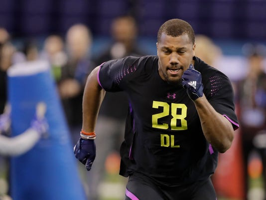 North Carolina State defensive lineman Bradley Chubb runs a drill during the NFL football scouting combine, Sunday, March 4, 2018, in Indianapolis. (AP Photo/Darron Cummings)