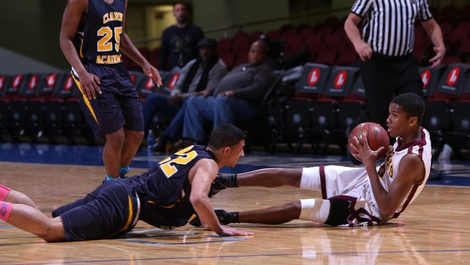 Biondi's Jaime Early looks to pass after diving for the ball along with Clark's Rayvonne Acosta in the Class D semifinals at the Westchester County Center, Feb. 27, 2017. Biondi won 67-59.