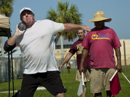 Gary Dixon, 57, competes in the men's masters division shot put on Sunday during the Sunshine State Games at Charlotte High.