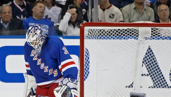 Rangers' fans react as the puck slides in behind Rangers goalie Henrik Lundqvist in the second period of the Pittsburgh Penguins 2-0 shutout on Monday.