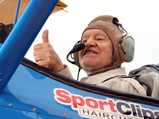 WWII Navy Veteran from Spring Hills Somerset Assisted Living, 90-year-old Angelo Caggeno gives a thumbs up before taking off on a Dream Flight in a restored 1940Õs PT-17 Stearman. The flights in an open cockpit World War II biplane were courtesy of Ageless Aviation Dreams Foundation, a non-profit dedicated to honoring seniors who have served in the United States Armed Forces. August 8, 2017. Wantage, NJ