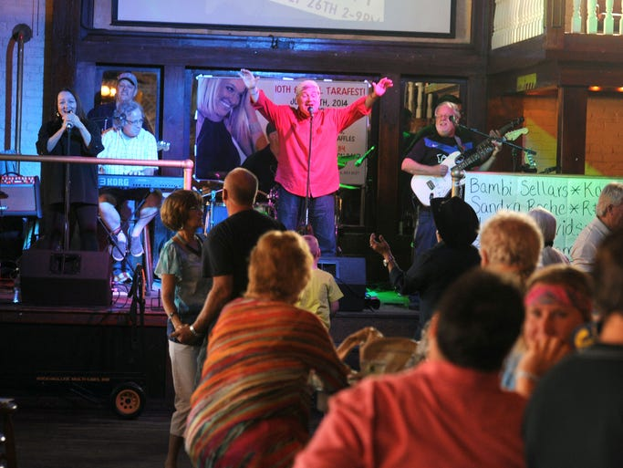 The Reunion Band performs for the crowd Saturday during Tarafest at Seville Quarter. All proceeds went to the Tara Blackwell Medical Fund.