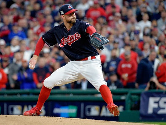 Cleveland Indians starting pitcher Corey Kluber delivers in the first inning against the New York Yankees in Game 5 of a baseball American League Division Series, Wednesday, Oct. 11, 2017, in Cleveland.