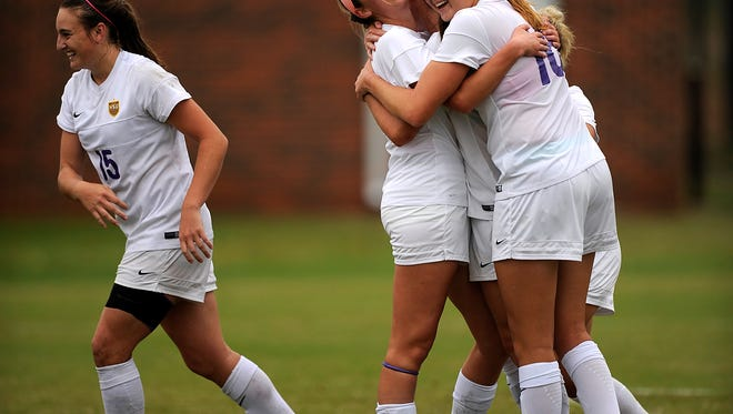 Hardin-SimmonsÕ Olivia Hartman (2) celebrates with teammate Kirsten Parrish (16) after a goal in the first half of the Cowgirls' 2-0 win in the semifinals of the American Southwest Conference tournament on Friday, Nov. 4, 2016, at the HSU Soccer Complex.