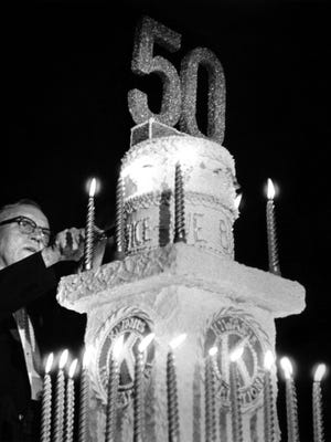 Harry A. Young, the last living founder of the Kiwanis Club of Detroit No. 1, cuts the cake a Kiwanis' 50th anniversary celebration at Cobo Hall on Jan. 21, 1965.