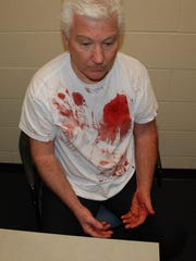 Timothy Sparks is photographed by Mason police before