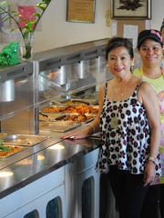 Nita Baldovino, front, founded Rambie's Filipino Restaurant in 1988. She is shown here with restaurant staff and her sisters Stella and Gloria.