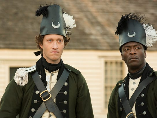 Freed slave Akinbode (Aldis Hodge) is one of SImcoe's
