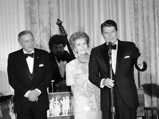 In this June 19, 1984, file photo, the Reagans address