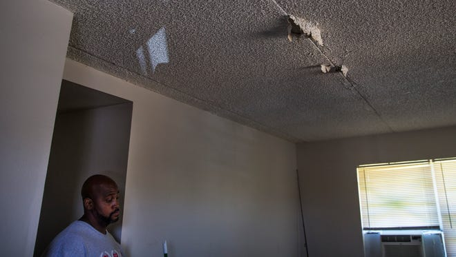 Anthony Washington stands below his leaking roof in the Gordon River Apartments on Tuesday, Sept. 12, 2017. Hurricane Irma tore off the roofs of two apartment buildings in the complex.