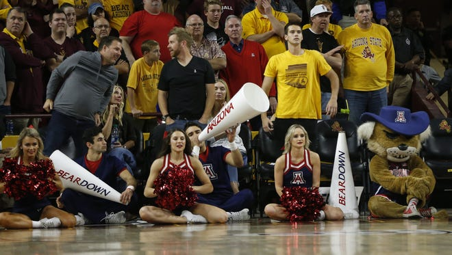 Arizona cheerleaders on the sideline during the second half at Wells Fargo Arena on February 15, 2018 in Tempe, Ariz.