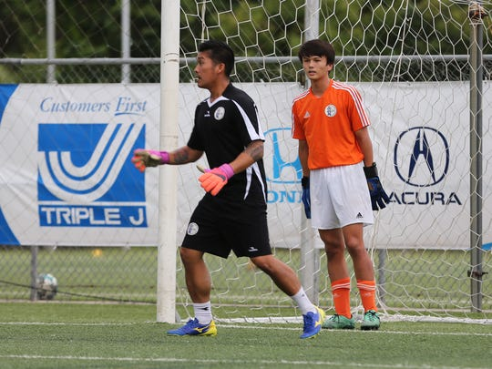 Guam U15 Boys National Team training squad goalkeeper Alexander Stenson listens to advice from Goalkeeper Coach Ross Awa during a recent training session at the Guam Football Association