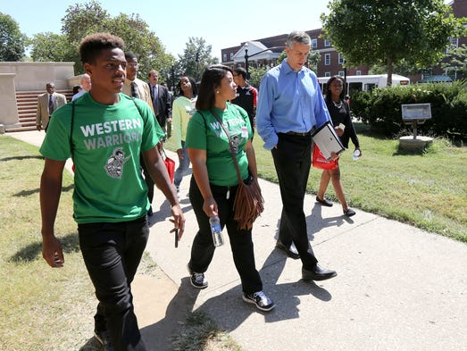 Education Secretary Arne Duncan, right, tours UofL's