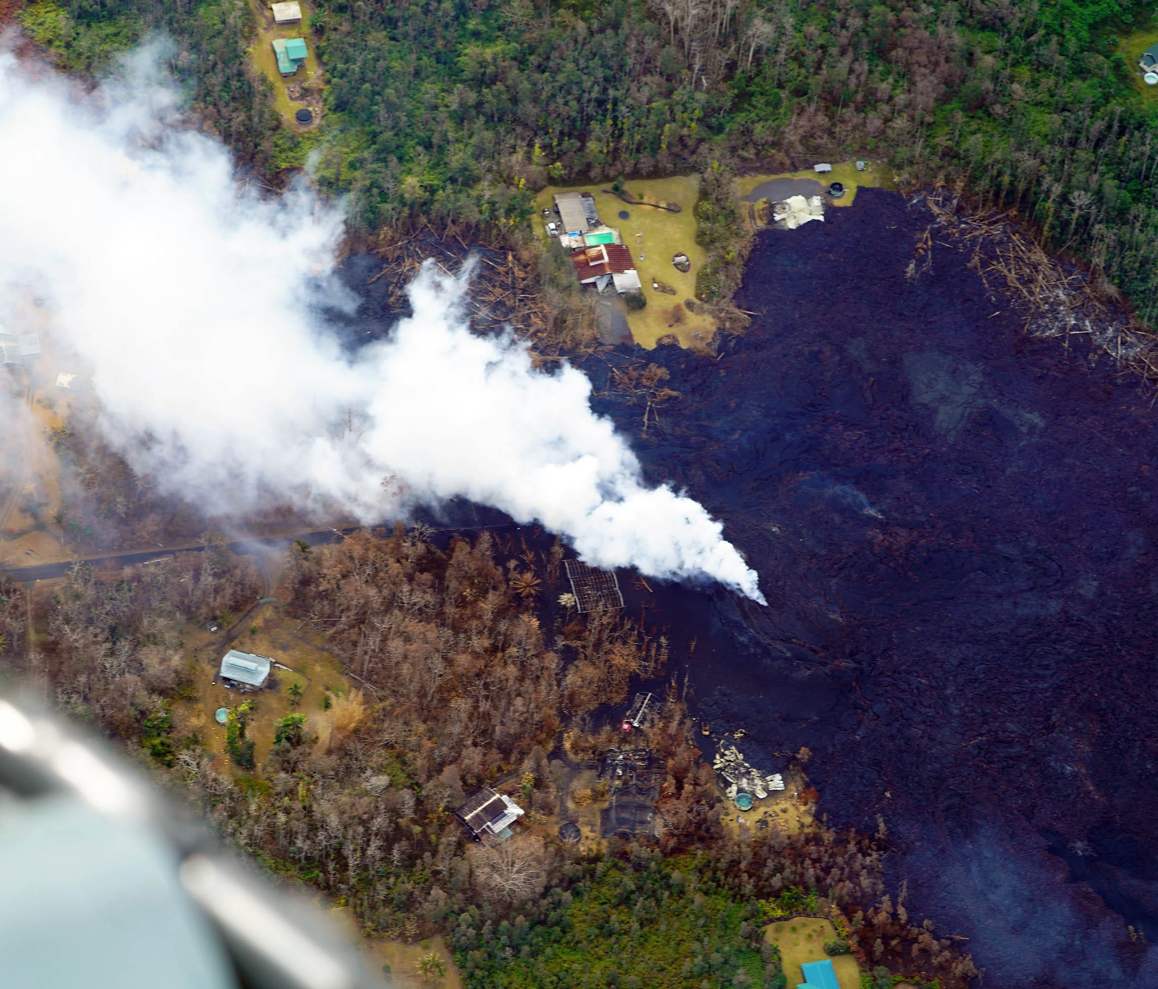 Fumes from the lava flow near the Leilani Estates neighborhood as seen on May 13, 2018, have killed surrounding vegetation.