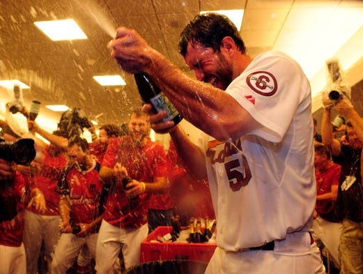 Game 5 -- Cardinals starting pitcher Adam Wainwright celebrates with teammates after defeating the Pittsburgh Pirates at Busch Stadium.