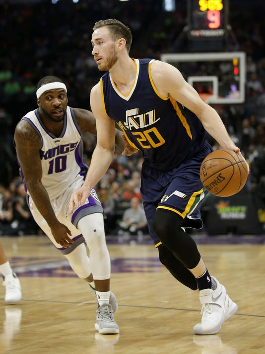 Utah Jazz forward Gordon Hayward, right, drives against Sacramento Kings guard Ty Lawson during the first half of an NBA basketball game Sunday, March 5, 2017, in Sacramento, Calif.(AP Photo/Rich Pedroncelli)