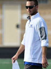 Walled Lake Western head coach Alex Grignon