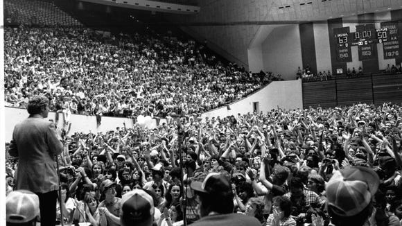Indiana University basketball coach Bobby Knight cheered by celebrating Hoosiers in Assembly Hall March 31, 1981, the day after IU defeated North Carolina 63-50 for the national title.