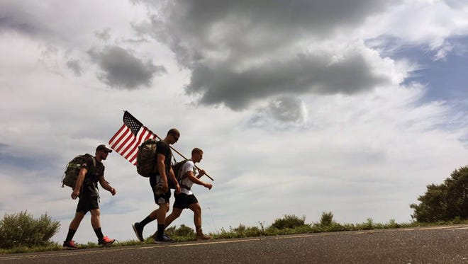 """""""For Them - 140 Mile Ruck"""", four St. Norbert College ROTC studentsembarked on a 140-mile ruck march to raise money for the 4th H.O.O.A.H. Wisconsin, a volunteer nonprofit that supports American veterans."""